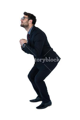 Businessman performing exercise