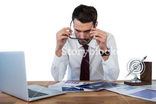 Businessman wearing spectacle while working in office