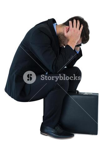 Depressed businessman sitting on steps