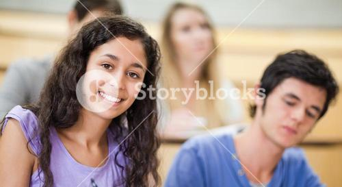 Smiling student in a amphitheater
