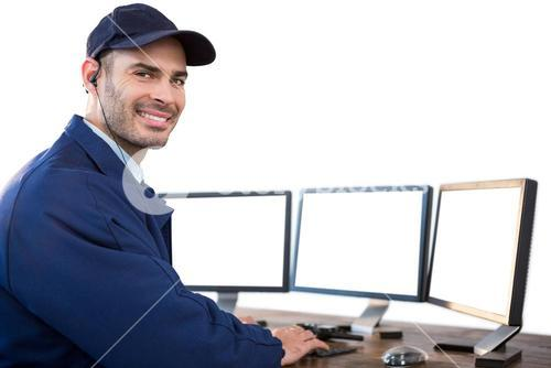 Happy security officer using computer