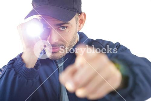 Security officer holding a torch