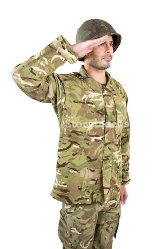 Close-up of soldier saluting