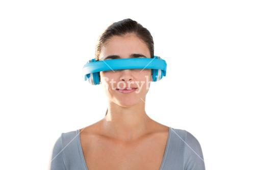 Smiling woman in exercise outfit using virtual video glasses