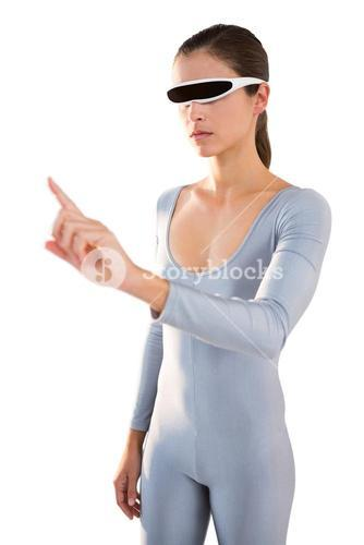 Woman in exercise outfit using virtual video glasses and pointing