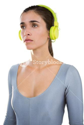 Woman in exercise outfit wearing headphones