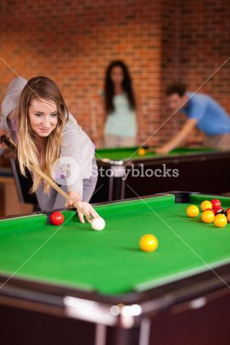 Portrait of a woman playing snooker