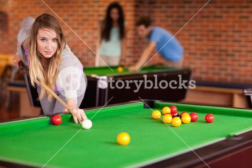 Student woman playing snooker