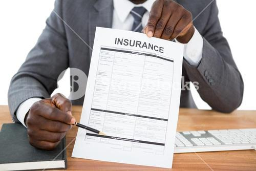 Businessman showing insurance document