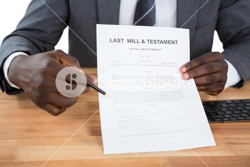 Businessman showing Last Will & Testament document