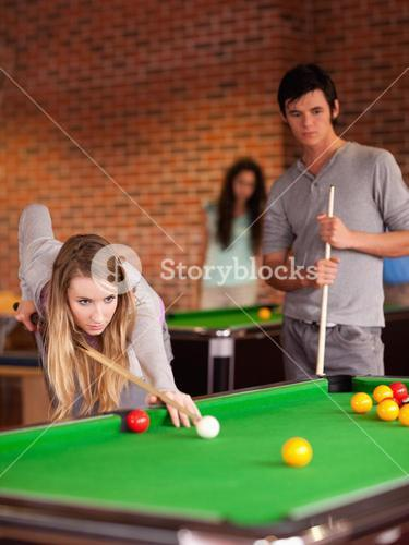 Portrait of friends playing snooker
