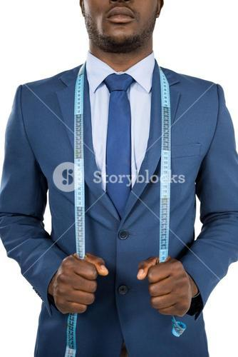 Businessman holding a measuring tape around is neck