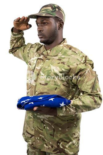 Portrait of soldier holding an american flag and saluting