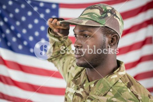 Soldier saluting against american flag
