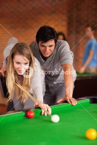 Portrait of a couple playing snooker
