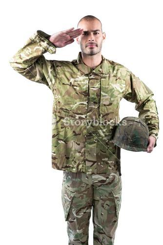 Portrait of confident soldier standing with a helmet
