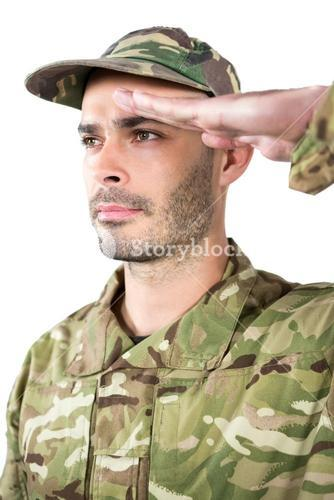 Close-up of confident soldier saluting