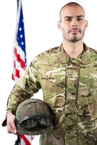 Portrait of smiling soldier standing with combat helmet