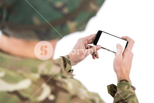 Soldier using a mobile phone