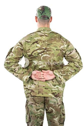 Rear view of soldier standing with his hands behind back