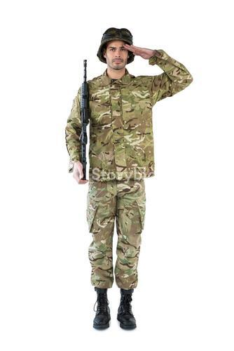 Portrait of soldier holding a rifle and saluting