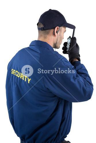 Security officer talking on walkie-talkie