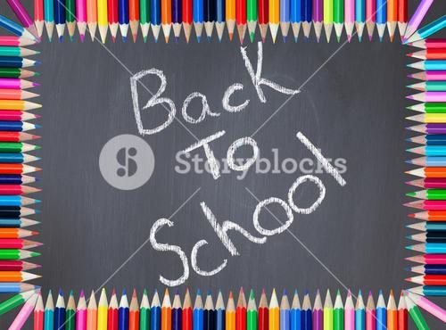 Back to school written on a blackboard framed with colored pencil