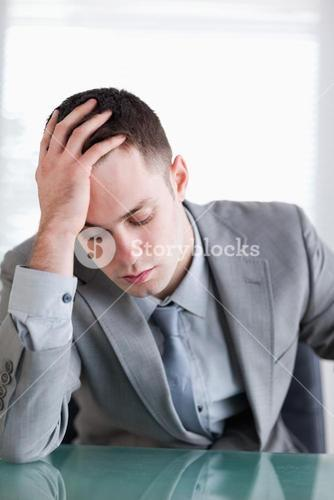Close up of disappointed young businessman