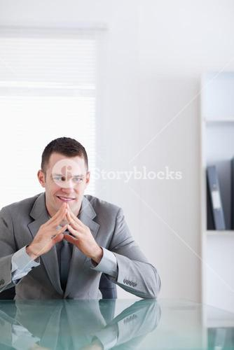 Close up of young businessman in a successful negotiation