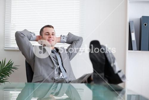 Smiling businessman taking a break