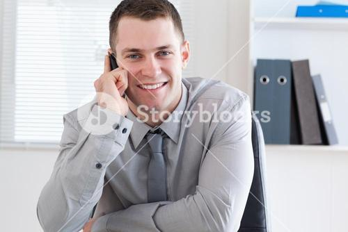 Businessman using his mobilephone