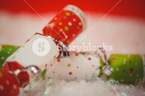 Close-up of christmas crackers on snow