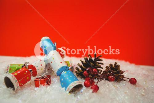Christmas crackers and christmas decoration on snow