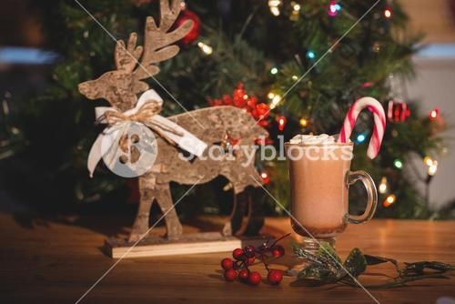Cup of coffee and christmas decoration on wooden table