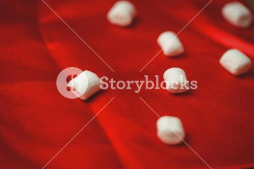 Sweet marshmallow on red cloth