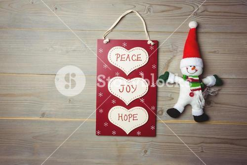 Christmas label with massages and santa claus on wooden table