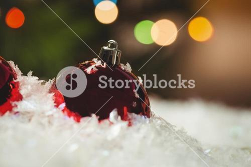 Close-up of christmas baubles on snow