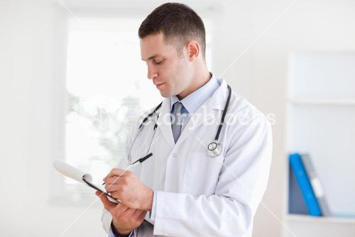 Doctor taking notes carefully