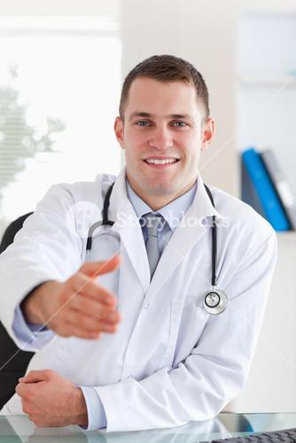 Smiling doctor extending his hand