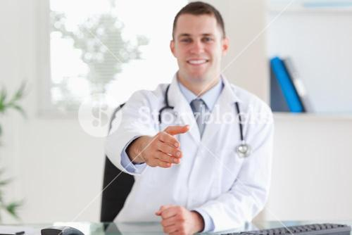 Smiling doctor welcoming patient