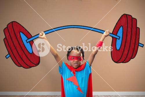Composite image of boy in superhero disguise standing with hands raised