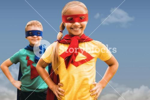 Composite image of siblings with hands on hip
