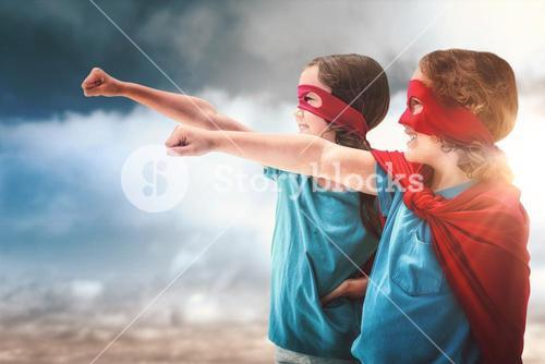 Composite image of sister and brother in red cape