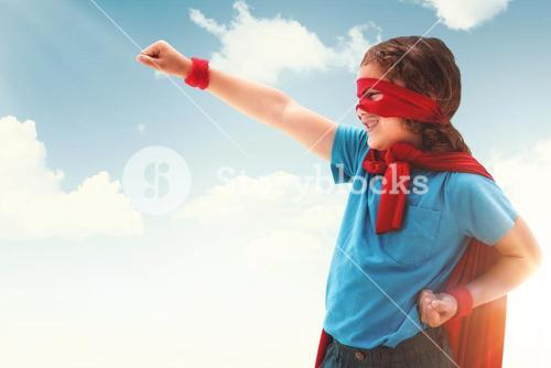 Composite image of happy boy in red cape
