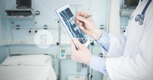 Composite image of doctor scrolling on a digital tablet