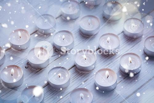 Candles burning on wooden table