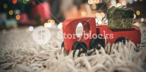 Toy car carrying christmas gift box