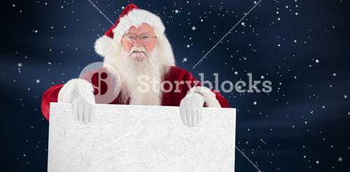 Composite image of santa is holding a sign