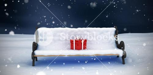 Composite image of digital image of gift box on park bench