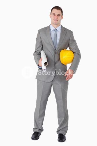 Smiling architect with helm and plans